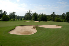 Sand bunker on golf course Stock Image