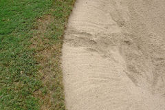 Sand bunker in golf course Royalty Free Stock Photo