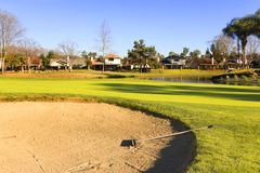Sand bunker on the golf course with green grass Royalty Free Stock Photography