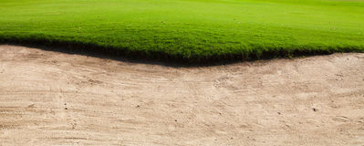 Sand bunker on the golf course Stock Images