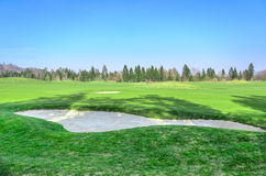 Sand bunker on the  golf course. Sand trap Royalty Free Stock Photography