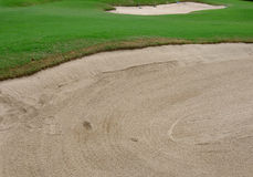Sand bunker in golf course Stock Photography