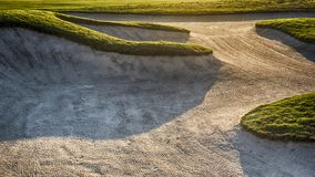 Sand bunker in a golf course on a sunset royalty free stock photos
