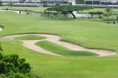 Sand bunker on golf field Royalty Free Stock Images