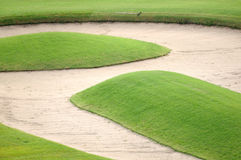 Sand bunker on golf field Royalty Free Stock Image