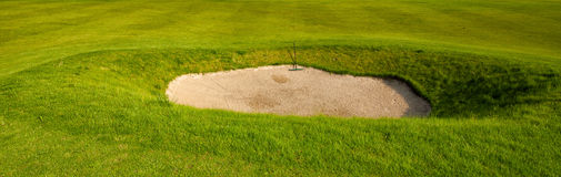 Sand bunker on the golf field Stock Images