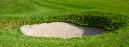 Sand bunker on the golf field Stock Image