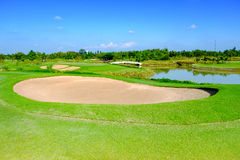 Sand bunker green golf field and blue cloud sky for backdrop background use Stock Image