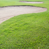 Sand bunker and green grass Stock Photo