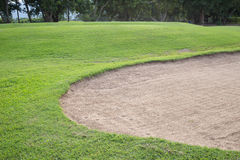 Sand bunker and green grass Stock Image