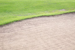 Sand bunker and green grass Royalty Free Stock Images