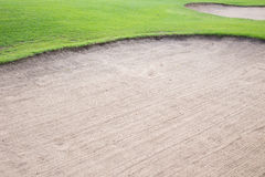 Sand bunker and green grass Royalty Free Stock Photo