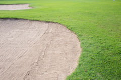 Sand bunker and green grass Royalty Free Stock Image