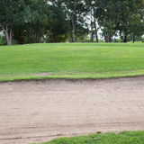 Sand bunker and green grass Stock Images
