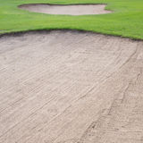 Sand bunker and green grass Stock Photos