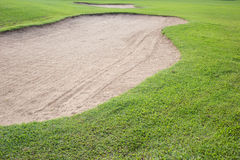 Sand bunker and green grass Royalty Free Stock Photography