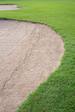Sand bunker and green grass Stock Photography