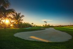 Sand bunkers at the beautiful golf course in the tropical island.  Royalty Free Stock Photos
