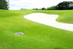 Sand bunkers on the golf course Stock Photo