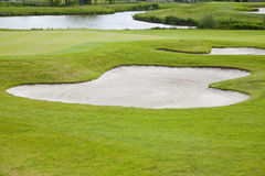 Sand bunkers on the golf course. Stock Image
