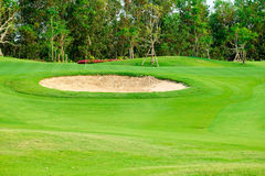 Sand bunkers and green golf in golf course Stock Photos
