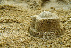 Sand cake on beach Stock Images