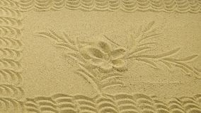 Sand from a candlestick with an ornament stock photography