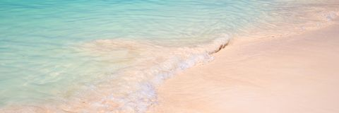 Sand and caribbean sea background. Sand and caribbean pristine sea background Royalty Free Stock Photography