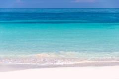 Sand and caribbean sea Stock Photos