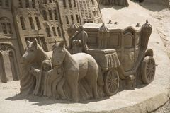 Sand Carriage. A horse and carriage in sand Stock Photos