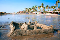 Sand castel on  beautiful tropical Vagator beach Royalty Free Stock Photo