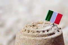 Sand castle. With Italian flag om the beach Royalty Free Stock Photo
