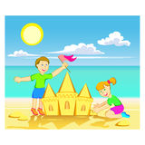 Sand castle. Boy and girl building sand castle on the beach Stock Images