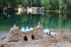 Sand castle, bank lake. Sand castle on the bank of lake Stock Photo