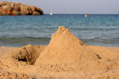 Sand castle on beach. With sea in background Stock Photo