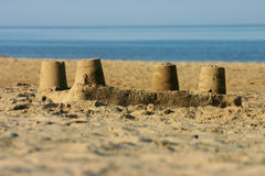 Sand castle on a beach. Stock Photos