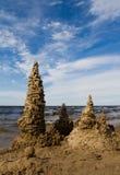 Sand castle at the beach Stock Photos
