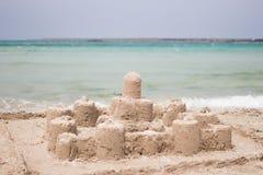 Sand castle on the beach stock photography