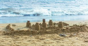 Sand castle on the beach stock image