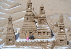 Sand castle on the beach Stock Photos