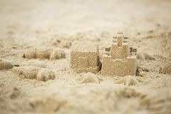 Sand castle on the beach. In close up royalty free stock images