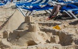 Sand castle in beach sand Stock Photography