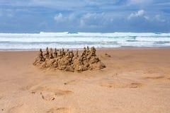 Sand castle on the beach Stock Photos