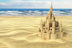 Sand castle on the beach on the sea and sky background. Stock Images