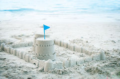 Sand castle beside the beach,summer time Stock Photos