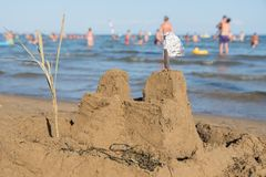 Sandcastle overlooking sea royalty free stock photography