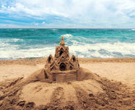 Sand castle on beach Stock Image