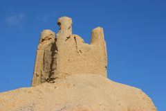 Sand castle with blue sky. As background Royalty Free Stock Images