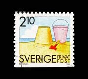Sand castle, bucket and spade, Rebate stamps - Summer Activities. MOSCOW, RUSSIA - AUGUST 18, 2018: A stamp printed in Sweden shows Sand castle, bucket and spade stock images