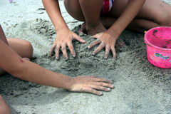 Sand Castle Buildng. Kids playing at the beach Royalty Free Stock Images